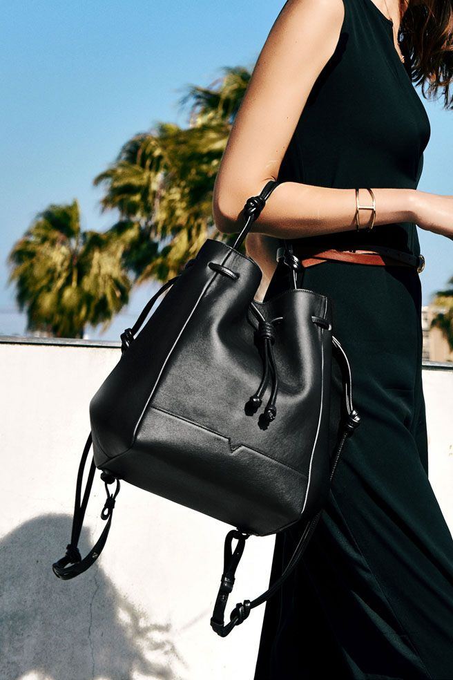 The Bucket from von Holzhausen. A minimal and chic bucket bag with removable straps that can be worn 3 different ways: as a backpack, a shoulder bag, or a bucket bag. Made in natural grained Italian leather with signature removable pouch.