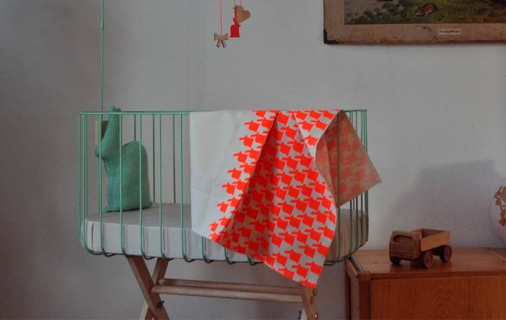 The Vintage Baby Crib is handmade from steel and painted with a baby friendly paint. It is made regarding public health care safety rules. The bars are distanced on 6,5 cm. The mattress size is 40 x 80 cm, and the bed height is 40cm. The stand height is 70 cm. This is higher than standard, so it's friendly for your back. The bed is available in the colors mint green, off-white and dark grey. The stand is made from wood. The crib is delivered with a mattress (40 x 80 cm) and a felt protect...