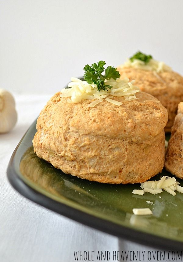 These golden, flaky biscuits have a lovely roasted garlic flavor and lots of cheddar cheese. Ready in minutes and so much better than boxed biscuits!   wholeandheavenlyoven.com