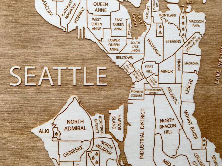 This engraved map shows the neighborhoods of Seattle, Washington