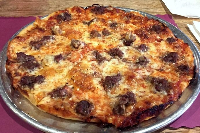Hamburger pizza from Damien's Pub, a restaurant and bar on Spring Street in Hanson, MA. (from http://hiddenboston.com/foodphotos/damiens-hamburger-pizza.html)