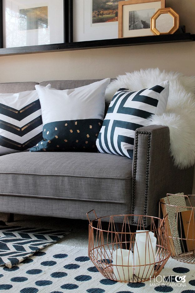 Customize inexpensive pillow covers with fabric paint and masking tape.