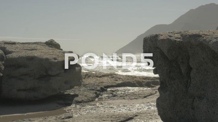 4K Sandy Beach Waves Hitting Rocks Sea Ocean Mountains - Stock Footage | by RyanJonesFilms
