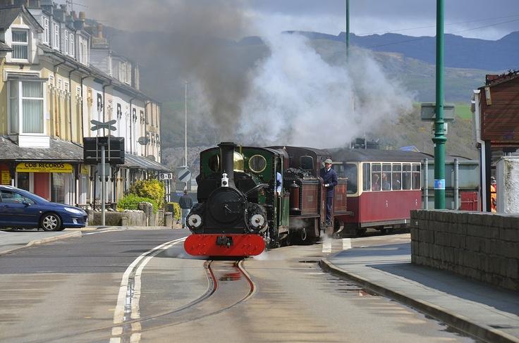 The steam train going through Porthmadog streets