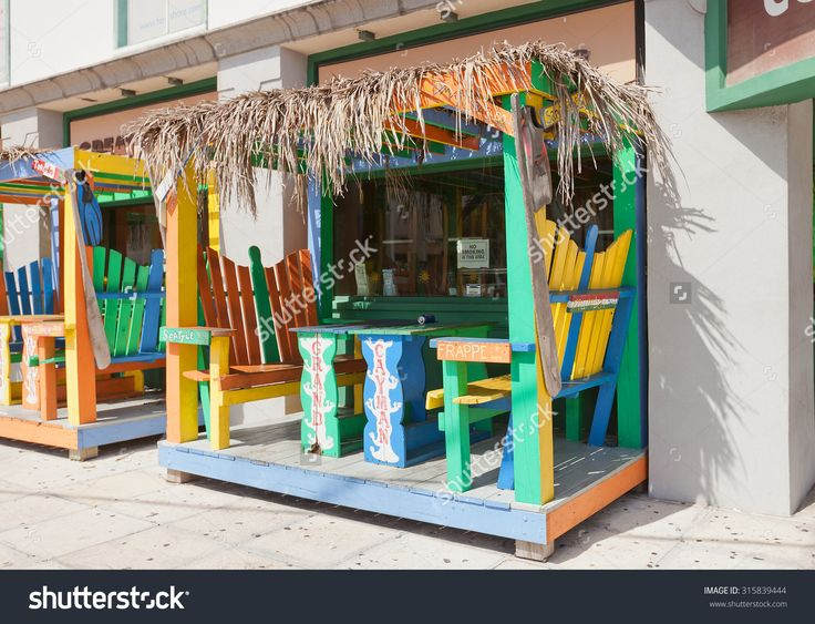 GEORGE TOWN, CAYMAN ISLANDS - SEPTEMBER 12, 2015: Colorful cabin of street cafe in George Town of Grand Cayman, Cayman Islands (British Overseas Territory)