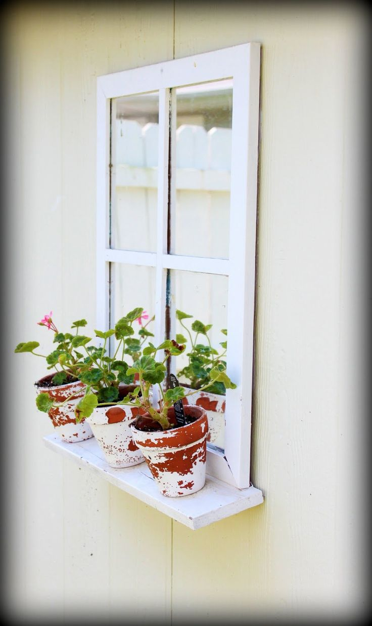 Shed window planter... old window spray painted with 'mirror' paint