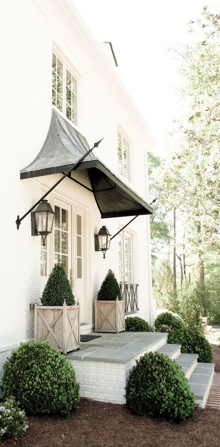 Beautiful front porch design with front door overhang | Scout For The Home