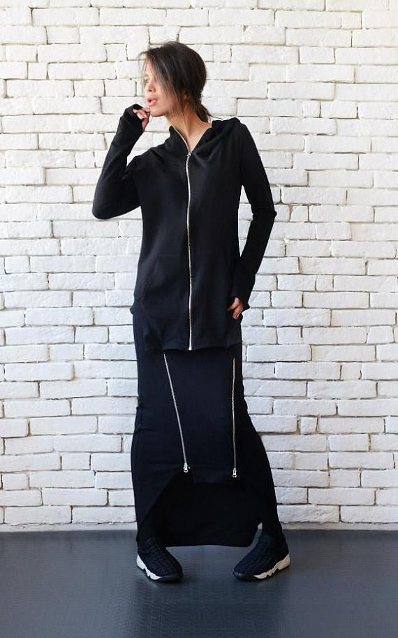 Black asymmetric hooded top - METT0094 Casual style has never been so cool and this asymmetric beauty proves it! This black top has a statement hood that can be worn up or down for a different look. We also have our favorite thumb hole sleeves that are a great addition to this sporty