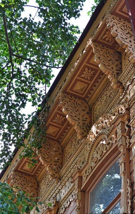 Russian wooden house. Carved decorations.: