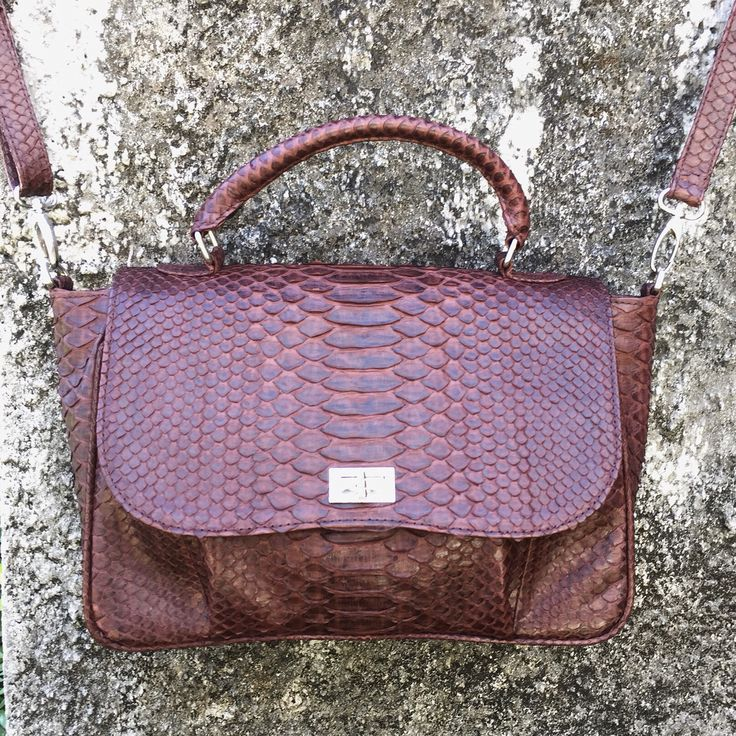 Bag from natural python skin with a removable cross-body strap. The bag is not big but you can wear cross-body or just in your hand. Taking orders on this model. You can choose the color and leather.
