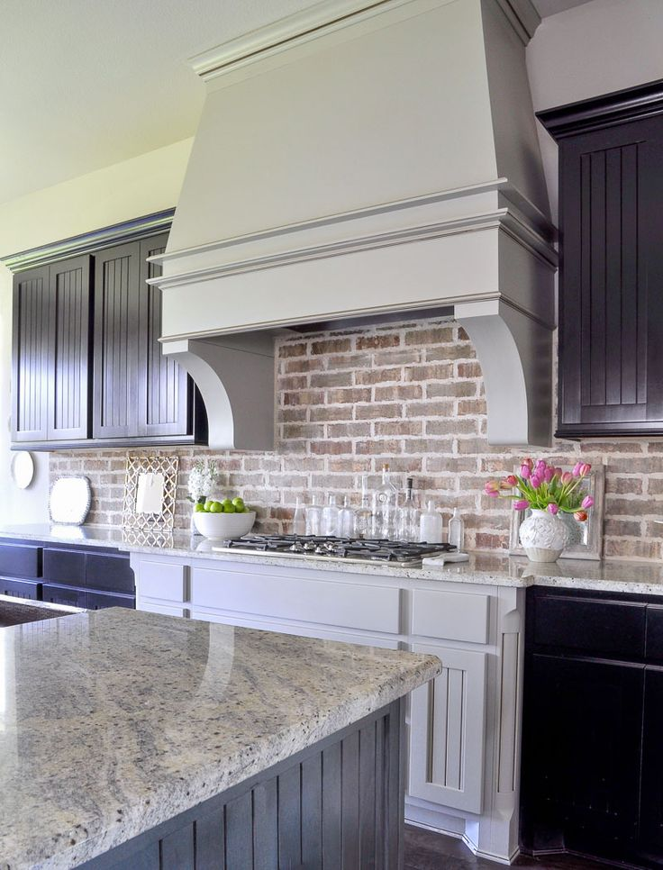 Beautiful kitchen with large vent hood