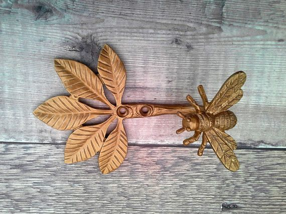 Gold Bee Wall Hook or a Curtain Tieback - inspired by our busy friends Dimensions -12.7 x 9.6 x 5.5 cm Made from Pewter will add a touch of glamour to any room. Price is for one supplied
