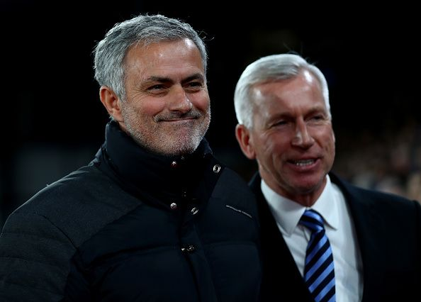 Jose Mourinho Manager of Manchester United and Alan Pardew Manager of Crystal Palace greet prior to the Premier League match between Crystal Palace...