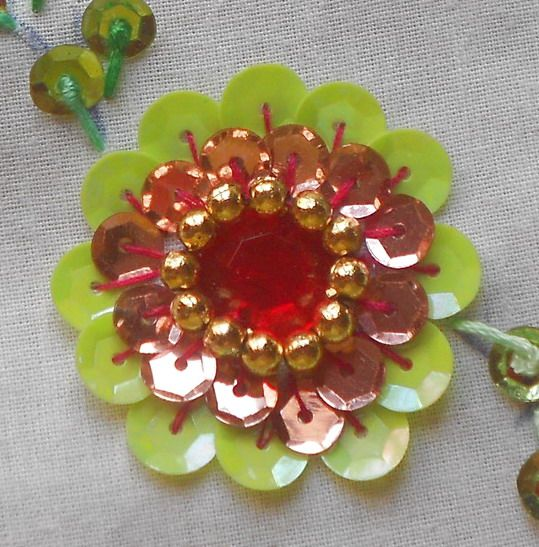 How to sew a sequin flower http://www.youtube.com/watch?v=-KMhSdJPxlE