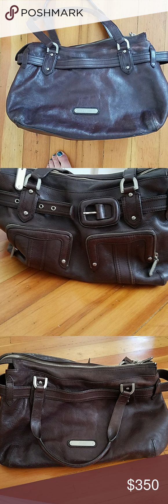 All seasons Cole Haan Purse A beautiful raisin color leather. It's a deep brown purple. The outside is in fantastic shape, with some signs of wear on the inside. Just had it professionally cleaned and reconditioned.   LOTS of room and great pockets! Cole Haan Bags