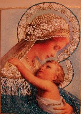 """January 1 is the Solemnity of Mary, the Mother of God. The beautiful picture above, called """" Blue Madonna"""" was painted by Irena Jakus. Irena's apostolate is called Holy Art - Jeweled Masterpieces for God's Glory. For more information on Irena's work, contact us."""