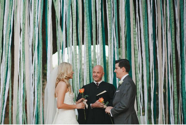 Lots and lots of hanging streamers feel fun and festive, adding a bit of whimsy to your big moment. Source