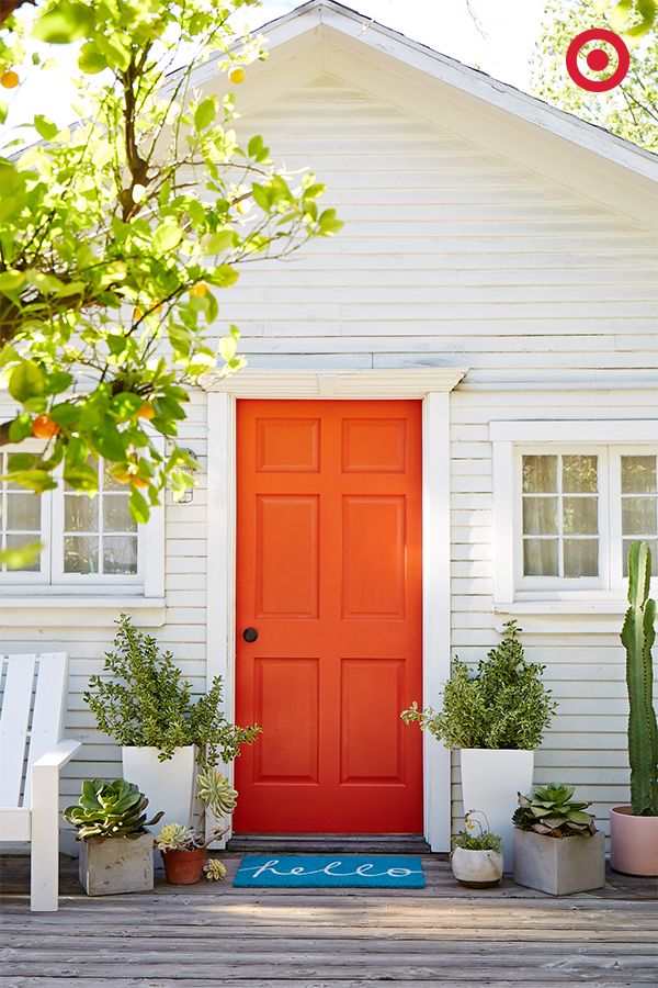 Welcome, summer! A bright and cheery doormat and plants around the door create a front porch you'll be happy to come home to.   ideas for the back porch