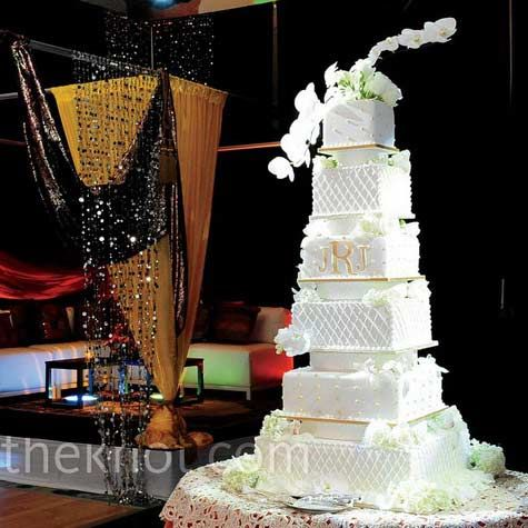 The couple chose a tall white and gold cake with a grand total of six tiers (yep, count 'em!) topped with fresh orchids.