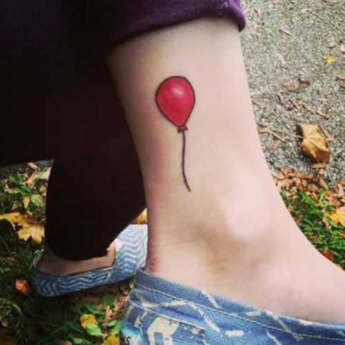 Red ballon tattoo on Jess Druzes ankle.