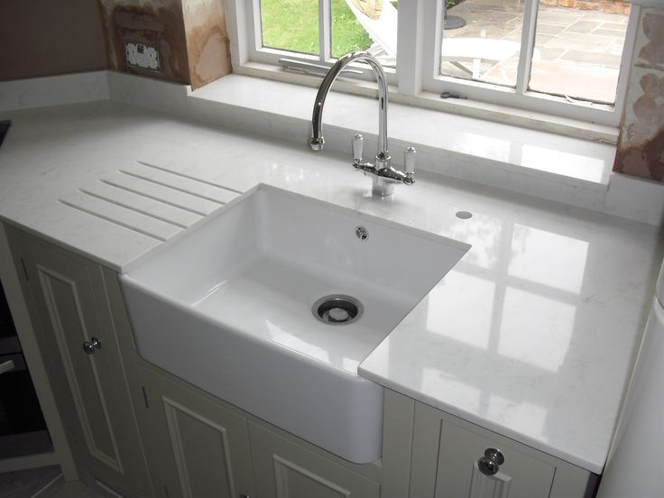 this belfast sink looks great with Carara quartz worktops from Compac, incorporating drainer grooves.