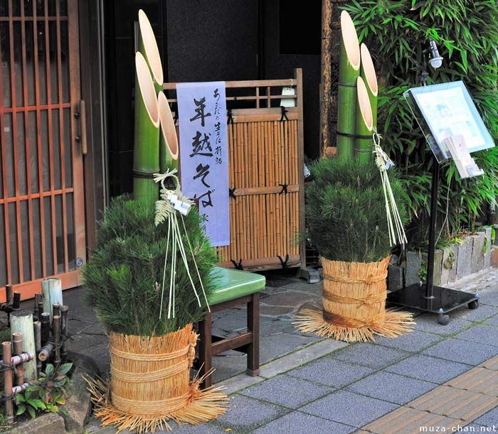 : Japanese New Year arrived! It's Ganjitsu--Typical New Year decoration is pine and bamboo settled together in front of houses and shops called kadomatsu. Pine symbolized longevity while bamboo signifies straightness and sincerity, added freshly cut plum branch stands for new life and new beginning. Japanese decorate facades of their houses with colorful kazari – house wearing  to attract fortune.