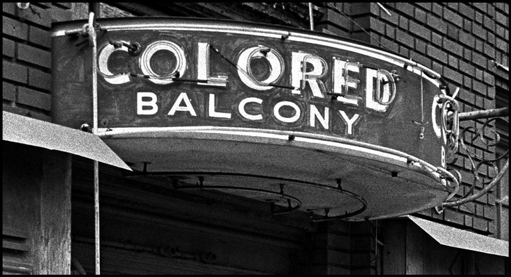 """Bob Adelman  USA. Birmingham, Alabama. 1963. A """"Colored Balcony"""" sign at a segregated theater. Birmingham had a well-deserved reputation as the most segregated and racially violent city in the Deep South.  Image Reference  NYC16275  (ADB1963940W00009/36)  © Bob Adelman/Magnum Photos"""
