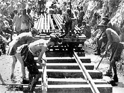 Explore: Behind the Wire - Prisoners of war laying track on the Burma-Thailand railway c.1943