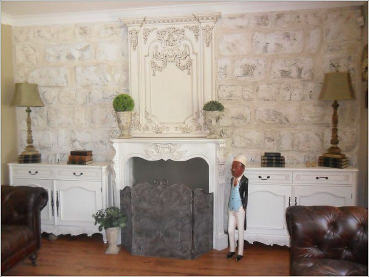 Fireplace surround and cabinets, perfect with the faux stone wall
