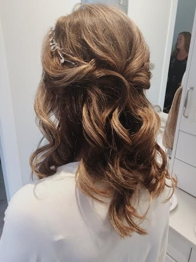 Bridal half-up do with braid and subtle crown
