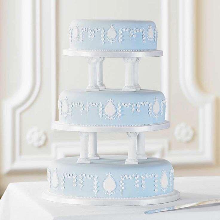 Bettys Imperial Oval Wedding Cake   Inspired by examples of traditional British craftsmanship, this unique cake is skilfully decorated with hand-piped patterns and delicate flowers. Each tier is covered in pale blue soft icing to complete the stunning look.    The elaborate design features carefully iced teardrops among the hand-piped leaves and beadwork. A pretty heart design is also available.