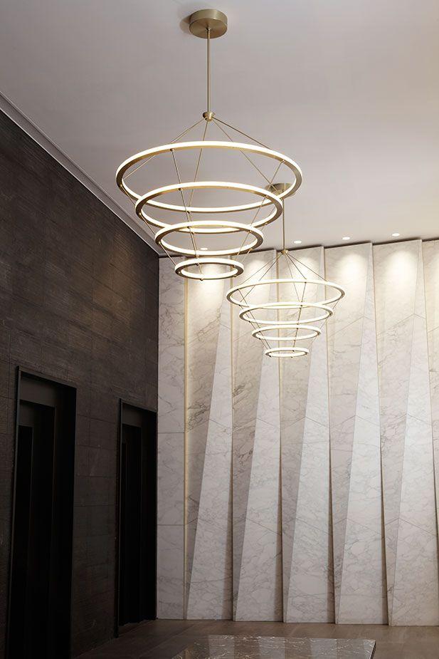 Transitional Lobby NYC | Geometric Stone Roll + Hill Lighting