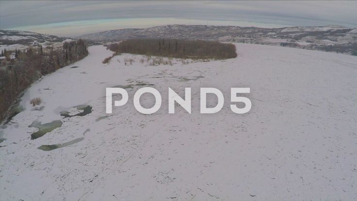 Aerial Shot Frozen River Hills Trees Forest Ice Winter Snow Drone Footage - Stock Footage | by RyanJonesFilms