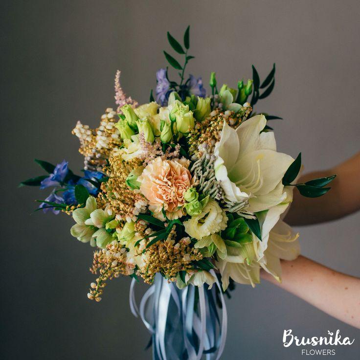 Hand-tied bouquet of delphinium, brunia, hippeastrum, amarillis, eustoma, ruscus, helleborus, pieris, carnation, astilbe