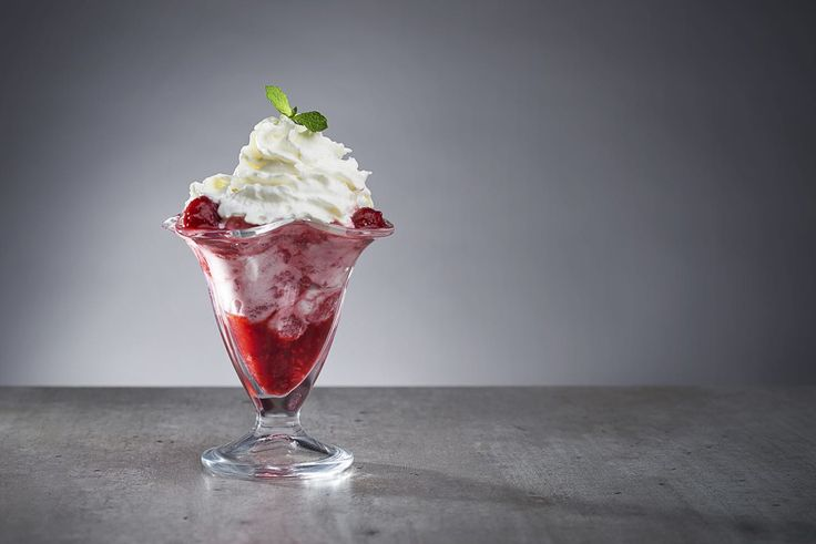 Eton Mess - popular sweet english dessert with raspberries and fresh whipped cream
