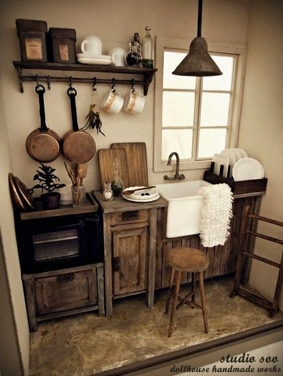 Kitchen out of the past...small scale.  Like the farmhouse sink, the distressed cabinets etc......just ideas