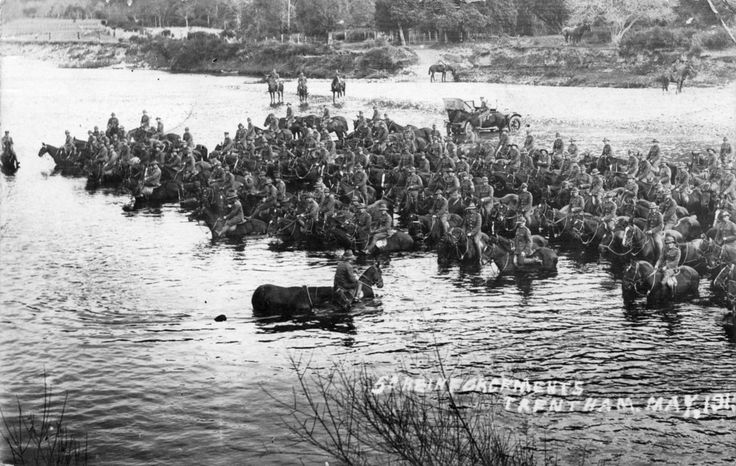Soldiers on horseback in Hutt River, Trentham [Postcard 011] | Upper Hutt City Library ca. 1915
