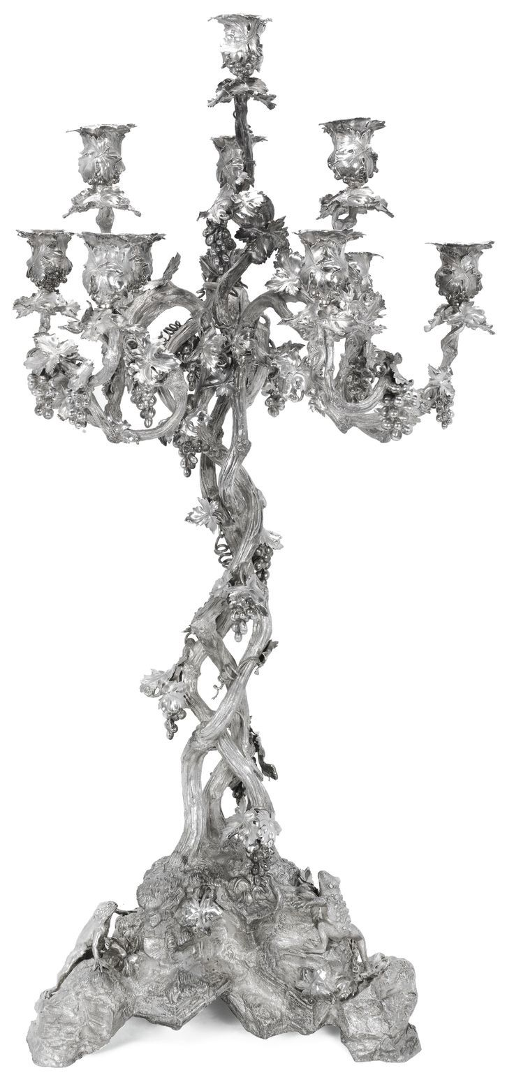 A LARGE VICTORIAN SILVER TEN-LIGHT CANDELABRUM, HUNT & ROSKELL, LONDON, 1845 the massive cast rocky base applied with a toad, a frog and a lizard below the twisted openwork vine stem with entwined snake, nine branches and central light, with ten vine-pattern sconces and detachable nozzles (two nozzles missing), maker's mark of John Samuel Hunt, stamped: 'STORR MORTIMER AND HUNT