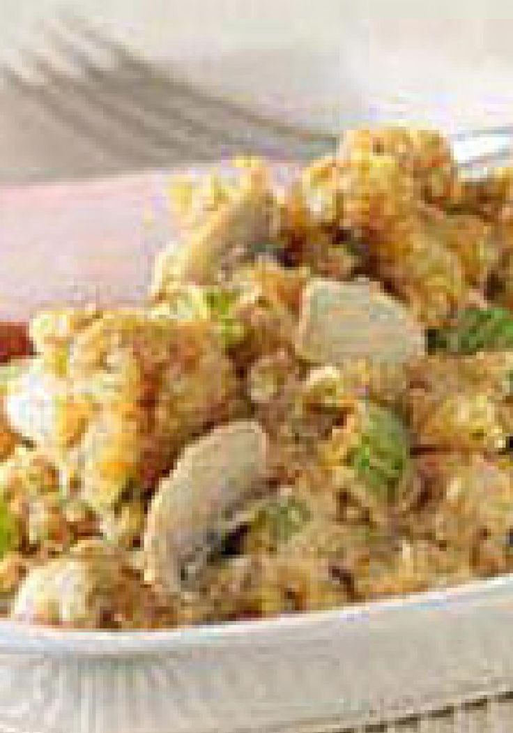RITZ Cracker Stuffing — Crushed buttery crackers replace the bread in this easy savory stuffing recipe that's flavored with walnuts, mushrooms and poultry seasoning.