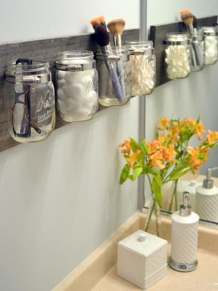 """Small+household+clutter+has+met+its+match+with+Mason+jars.+Casey+Finn+of+DIY+Playbook+discovered+a+way+to+use+the popular+glass+vessels+to+store+stuff+in+style.+""""We+live+in+a+small+condo+in+Chicago,+and+that+means+that we+don't+have+a+ton+of+storage,""""+Finn+explains."""