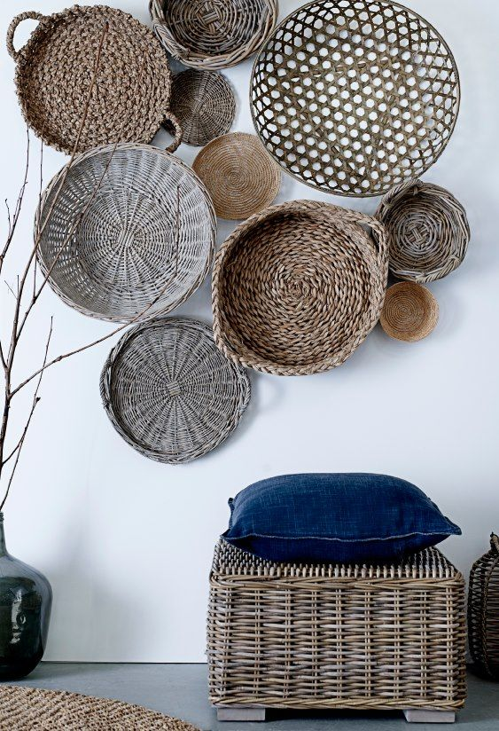 Interesting wall with round bamboo baskets | Living room inspiration