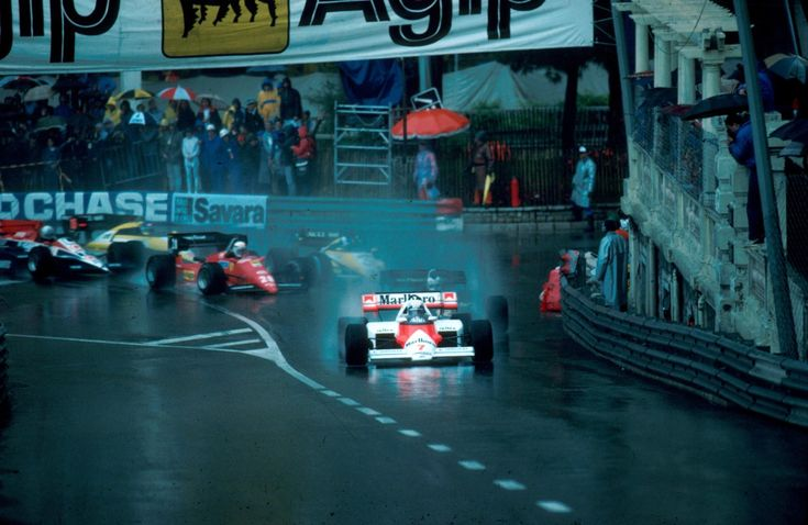 Monte Carlo, June 1984: McLaren's Alain Prost leads the opening stages of the Monaco Grand Prix. Prost went on to win from a charging Ayrton Senna when the race was stopped after 31 laps due to the wet conditions. © Sutton    © No reproduction without permission.