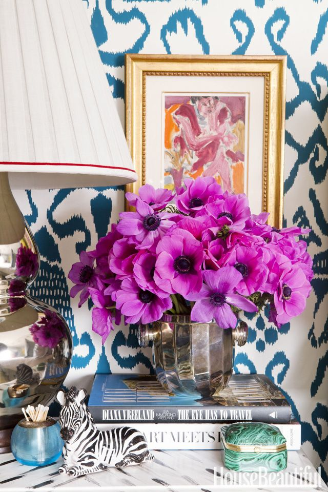 Bedroom Decorating Ideas. Bedside table vignette with purple Anemones