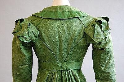 An emerald green figured silk pelisse robe, circa 1815-20. Kerry Taylor Auctions