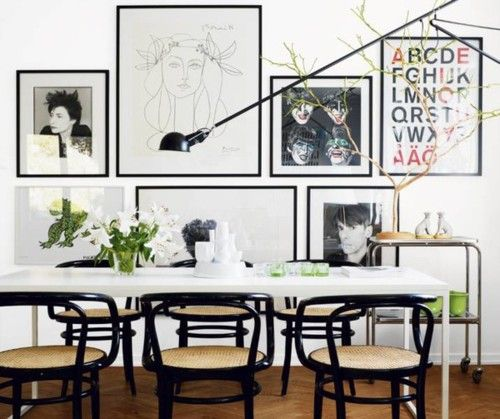 white walls, black Thonet chairs, herringbone floors, black-framed art, #diningroom