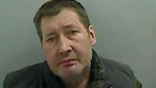 """Michael Dunn violent paedophile who made a """"hidey hole"""" in his home to conceal a girl he was abusing has been jailed for 27 years. Michael Dunn knocked through the wall behind his fridge to create a cavity to hide the runaway girl from police. Teesside Crown Court heard the 57-year-old, from Redcar, raped and abused four girls over a period of decades. His offences took place around the country, including at a house in Mottram near Hyde, Greater Manchester."""