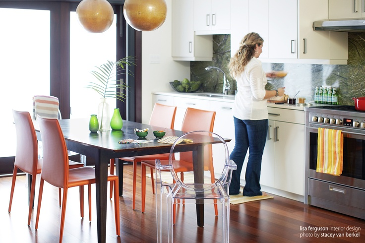 Danforth Kitchen | Mahogany tri fold doors hardwood floors marble backsplash and custom cabinets  Photography Stacey Van Berkel  www.lisafergusoninteriordesign.com