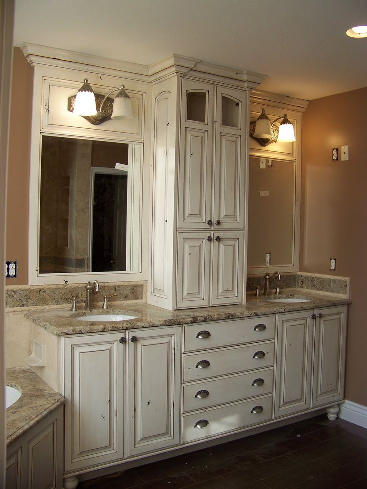 smaller area for double sinks but i like the storage cabinet inbetween more white bathroom double
