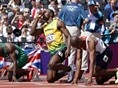 Jamaica's Usain Bolt, Britain's James Dasaolu, right, and Nigeria's Ogho-Oghene Egwero line up on the start blocks.
