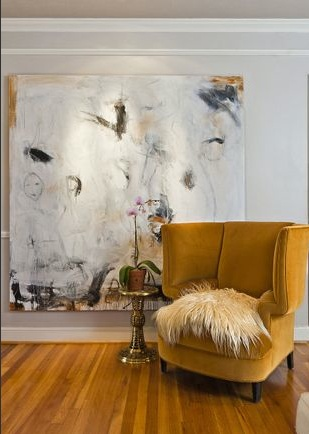 Custom wingback from Again & Again in Schumacher's Rusty Orange Velvet and abstract painting from Dallas Artist Chris Schumacher.